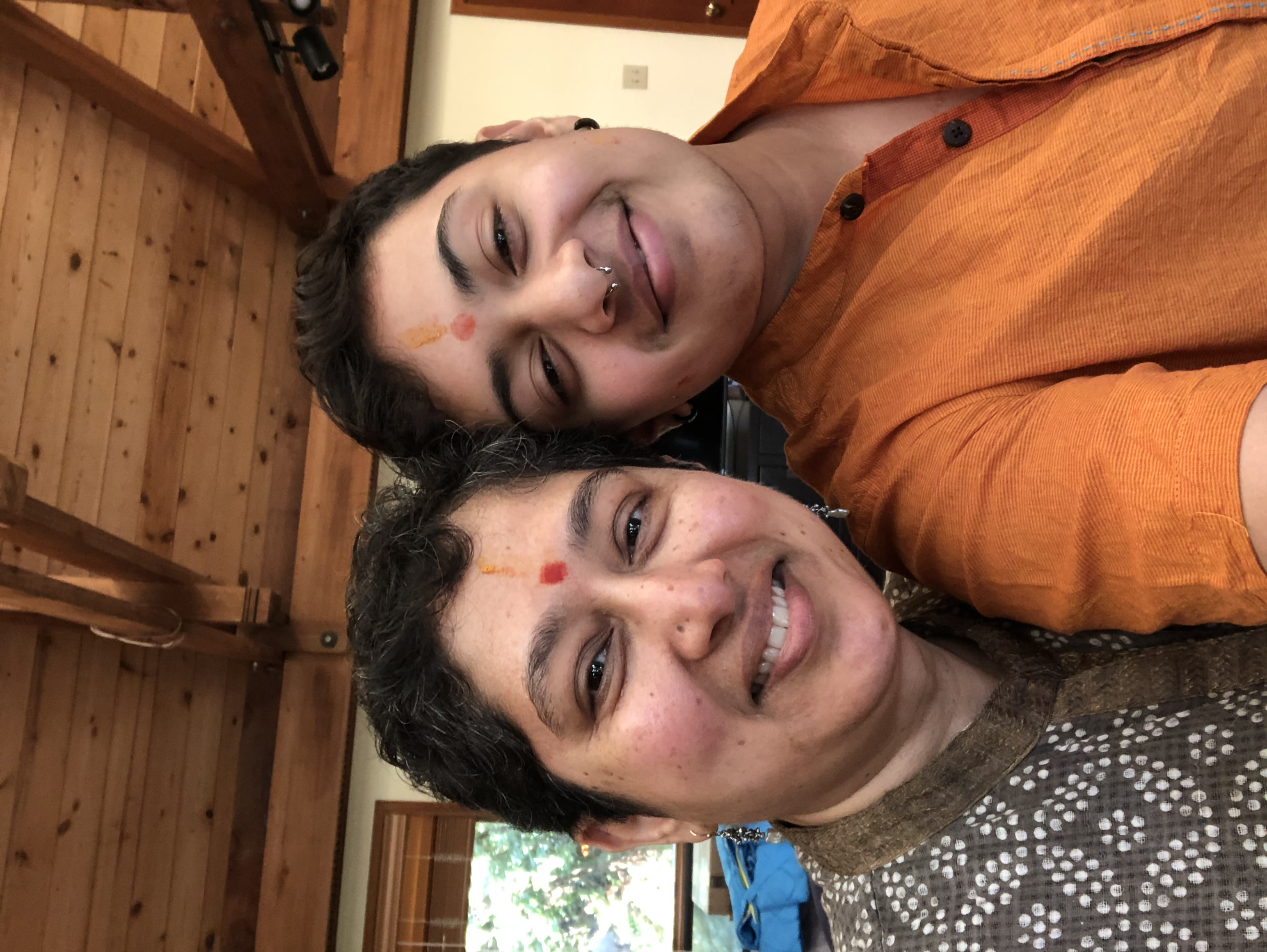 Hindu mother and son smile together